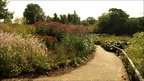 View of a path and flowering border in the Millennium Garden at Pensthorpe Nature Reserve