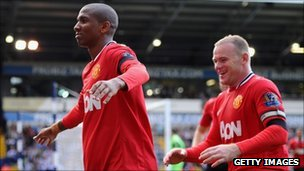 Ashley Young of Manchester United (left) celebrates scoring a goal for the club