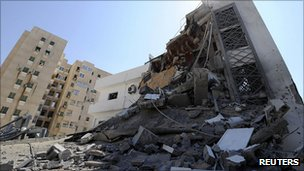 Building in Tripoli hit during Nato air raid. 20 Aug 2011
