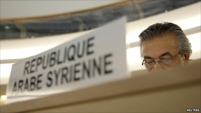 Syrian ambassador to the UN behind his desk