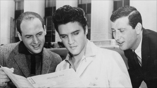 Rock and roll songwriters Jerry Leiber (R) and Mike Stoller are shown with singer Elvis Presley