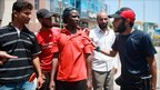 Libyan rebels question sub-Saharan African man as they search for pro-Gaddafi soldiers, Tripoli (22 August)