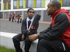 A School Reporter from Hackney Free and Parochial School  interviews hurdler Daniel Davies