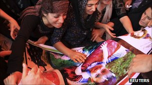 Women in Rania, northern Iraq, mourn a child said killed by Turkish action, 2 August