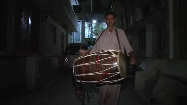 Rawalpindi drummer in Pakistan - wakes up the locals for their dawn prayers and meal.