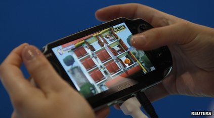 A person testing the PlayStation Vita.