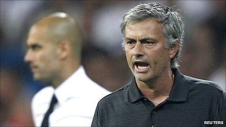 Jose Mourinho (right) with Barca boss Pep Guardiola (background, left)