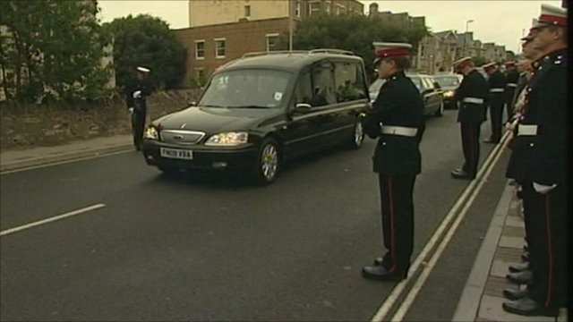 The funeral procession carrying the body of Royal Marine James Wright