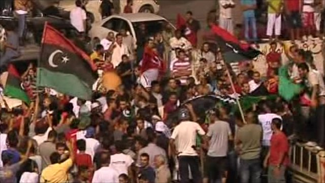 Rebels celebrate entering the Gaddafi compound
