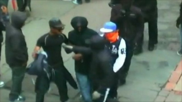 CCTV of looters fighting over goods