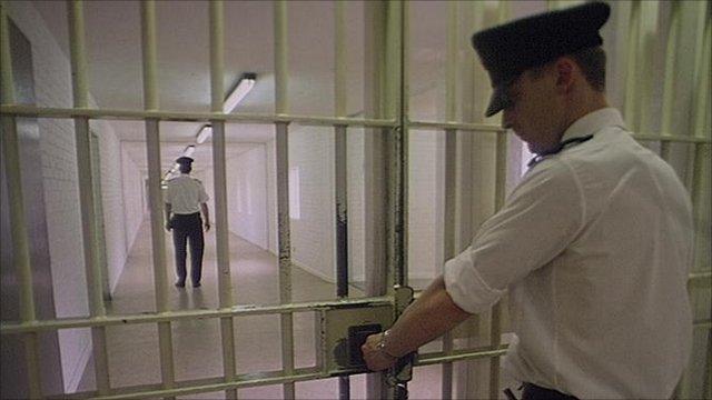Prison warden locks door