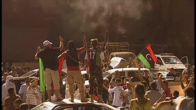 Rebels celebrate having seized Gaddafi compound