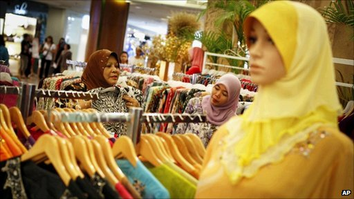 Malaysian Muslims shop for clothes at a mall