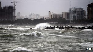 Storm surge waves battered the Dominican capital Santo Domingo on Tuesday