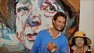 A photo taken on April 15, 2011 shows artist Ben Quilty (C), stands with legendary Australian painter Margaret Olley (R)