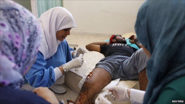 Man receiving medical treatment in Tripoli