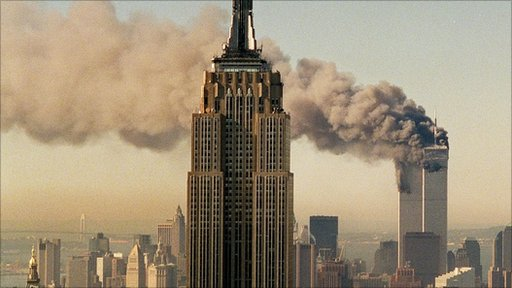 The twin towers of the World Trade Center burn behind the Empire State Buildiing