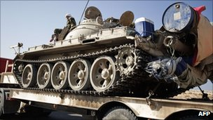 A rebel tank sits on a low-loader en route to Sirte, 24 August
