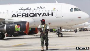 A rebel fighter takes up position at Tripoli Airport August 25