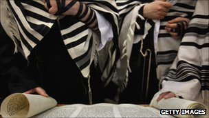 Orthodox Jews read a scroll of the Torah in a synagogue (file photo February 2010)