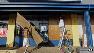 Men board up a shop in Nags Head, North Carolina