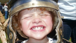 Girl wearing a Roman helmet at Fort George