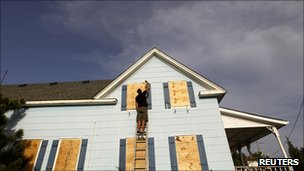 Resident boarding up his house in North Carolina