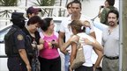 Family members hug after an attack on a casino in Monterrey, 25 August 2011