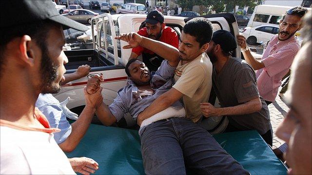 Man arriving at a Tripoli hospital