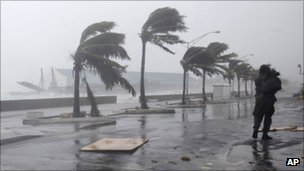 A man walks along the waterfront as Hurricane Irene passes to the east of Nassau on New Providence Island in the Bahamas, 25 August 2011
