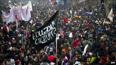 Students and workers take part in a demonstration in Santiago, Chile, on Thursday, during a two-day strike demanding political and economic reform