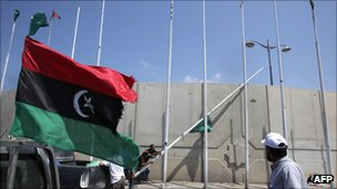 Green flags are lowered and rebel flags raised in Tripoli