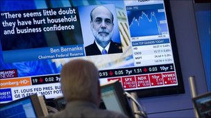 Trader watches coverage of Bernanke speech