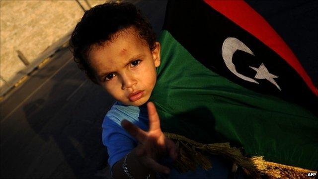 Boy in Tripoli with rebel flag