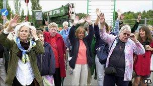Peace camp members watch the last caravan leave in September 2000
