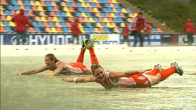Dutch players celebrate in rain