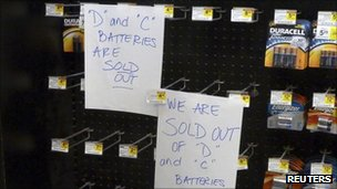 Signs indicating batteries were sold out are displayed in a Northern Virginia supermarket