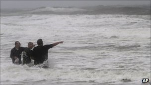 Virginia Beach visitors point out the waves as Hurricane Irene approaches,Virginia  27 Aug