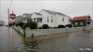 Flood waters on a street in Maryland on 27 August 2011