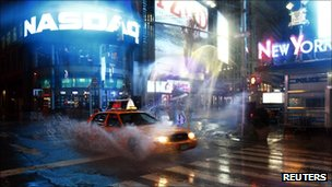 A taxi speeds by on 42nd Street at Times Square in New York