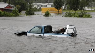 Floodwaters surround a pickup truck in New Bern, NC, Saturdayon 27 August 2011