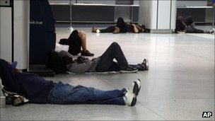 People sleep at Penn Station in New York, early Sunday