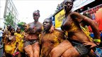 Revellers covered in chocolate at the Notting Hill Carnival
