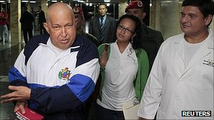 Hugo Chavez, left, in hospital in Caracas