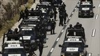Federal police officers are seen during an operation in Monterrey, northern Mexico, Sunday, Aug. 28, 2011.