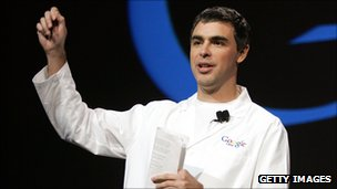 Larry Page in white lab coat