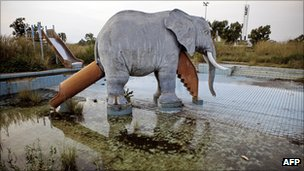 Picture taken on November 22, 2010 in Nesle shows an elephant set up in the swimming pool in the former residence of late dictator Mobutu Sese Seko