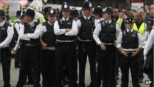 Police officers stand on duty during the second day of the Notting Hill Carnival