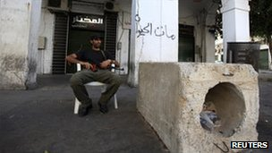 Rebel fighter guarding checkpoint in Tripoli