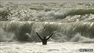 As Irene passed Canada, a brave swimmer waded into the storm-churned waves